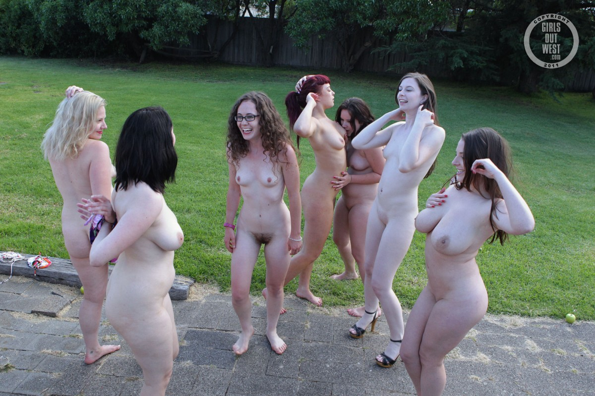 Hundreds pose nude wearing only masks in london art installation